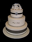 gallery-three-tier-wedding-cake-roses-and-diamantes-black-lace-inspired-by-michelle.jpg